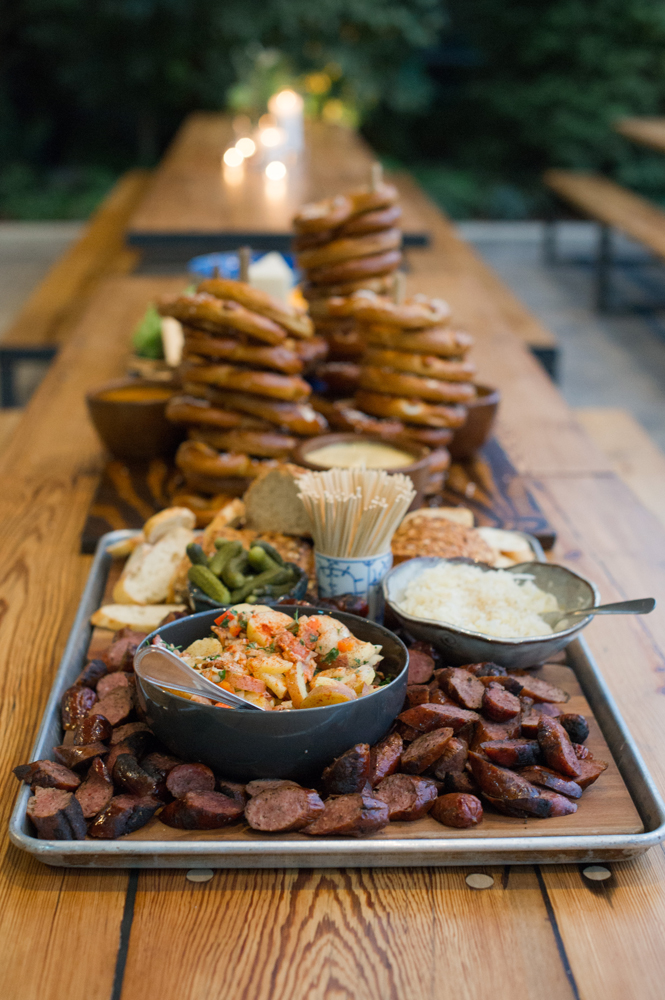 pretzels, sausages and cheese on a table