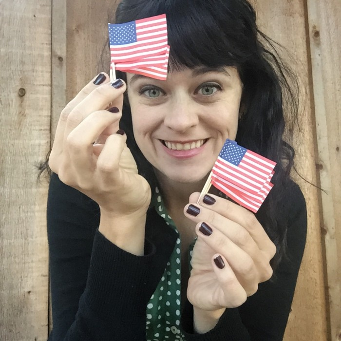 carrie rollwagen holding tiny american flags