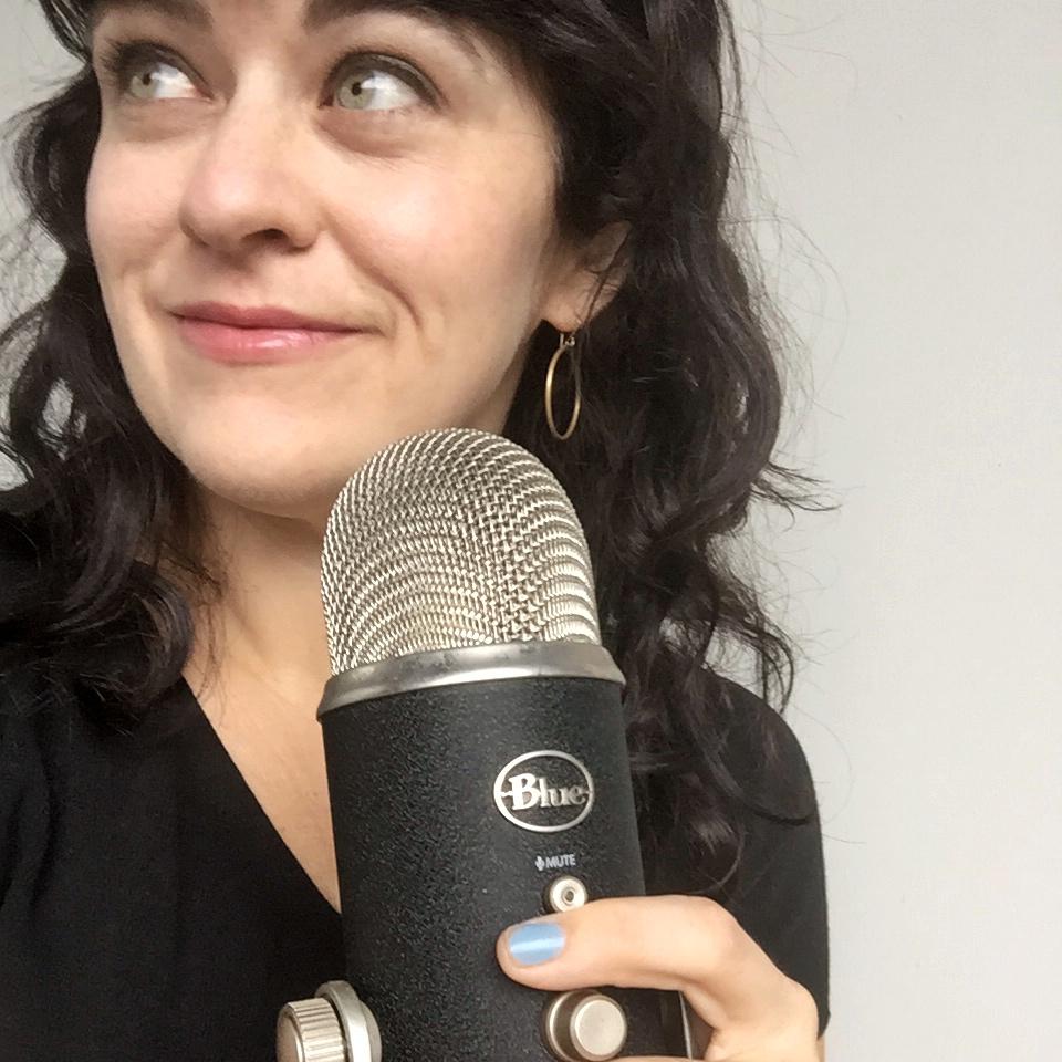 carrie rollwagen holds podcast mic