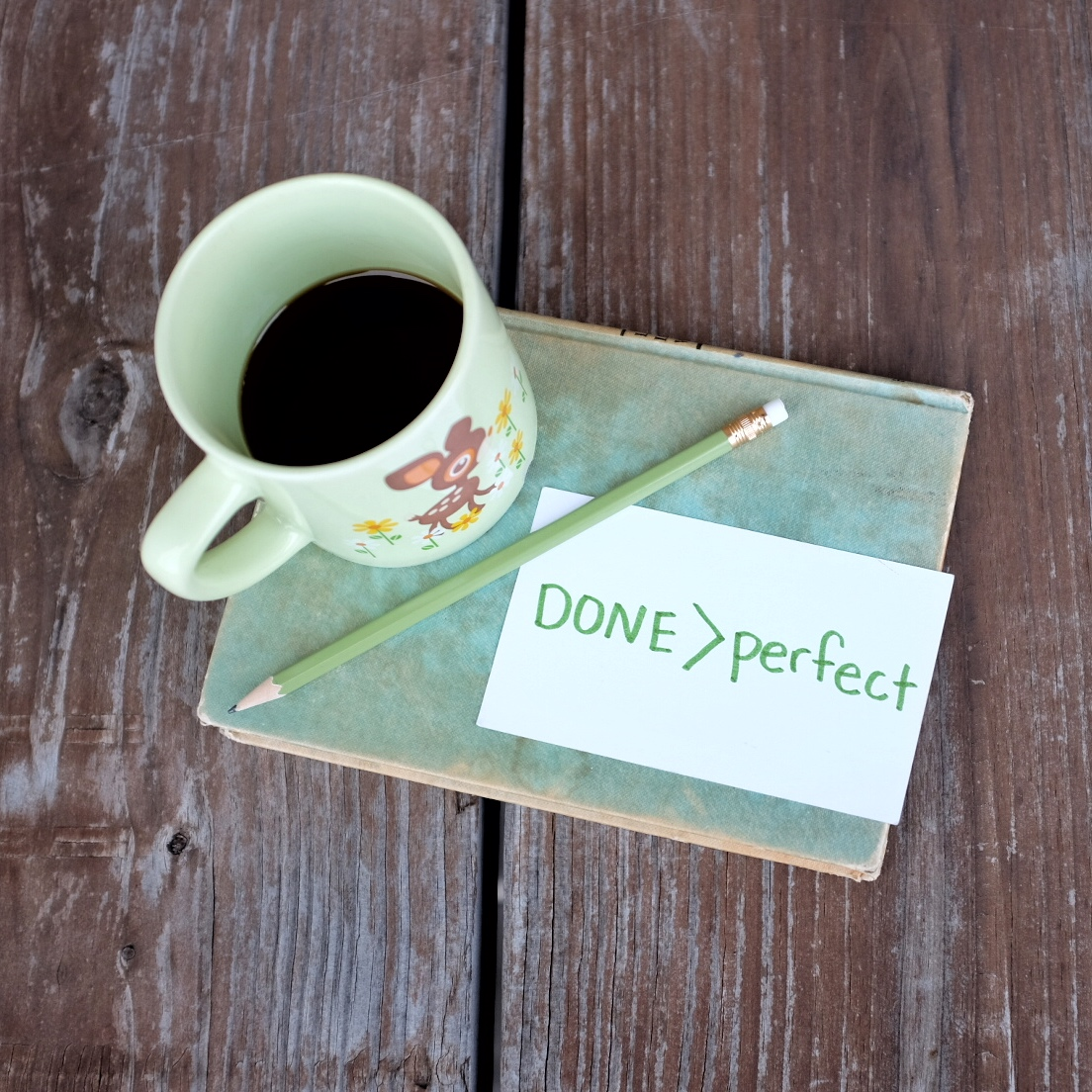 coffee cup and done is better than perfect message on a notecard