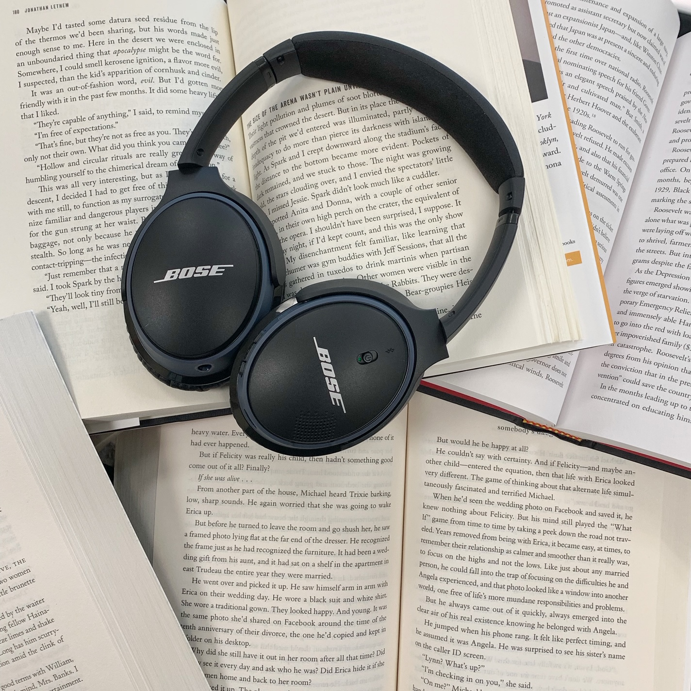 headphones on books