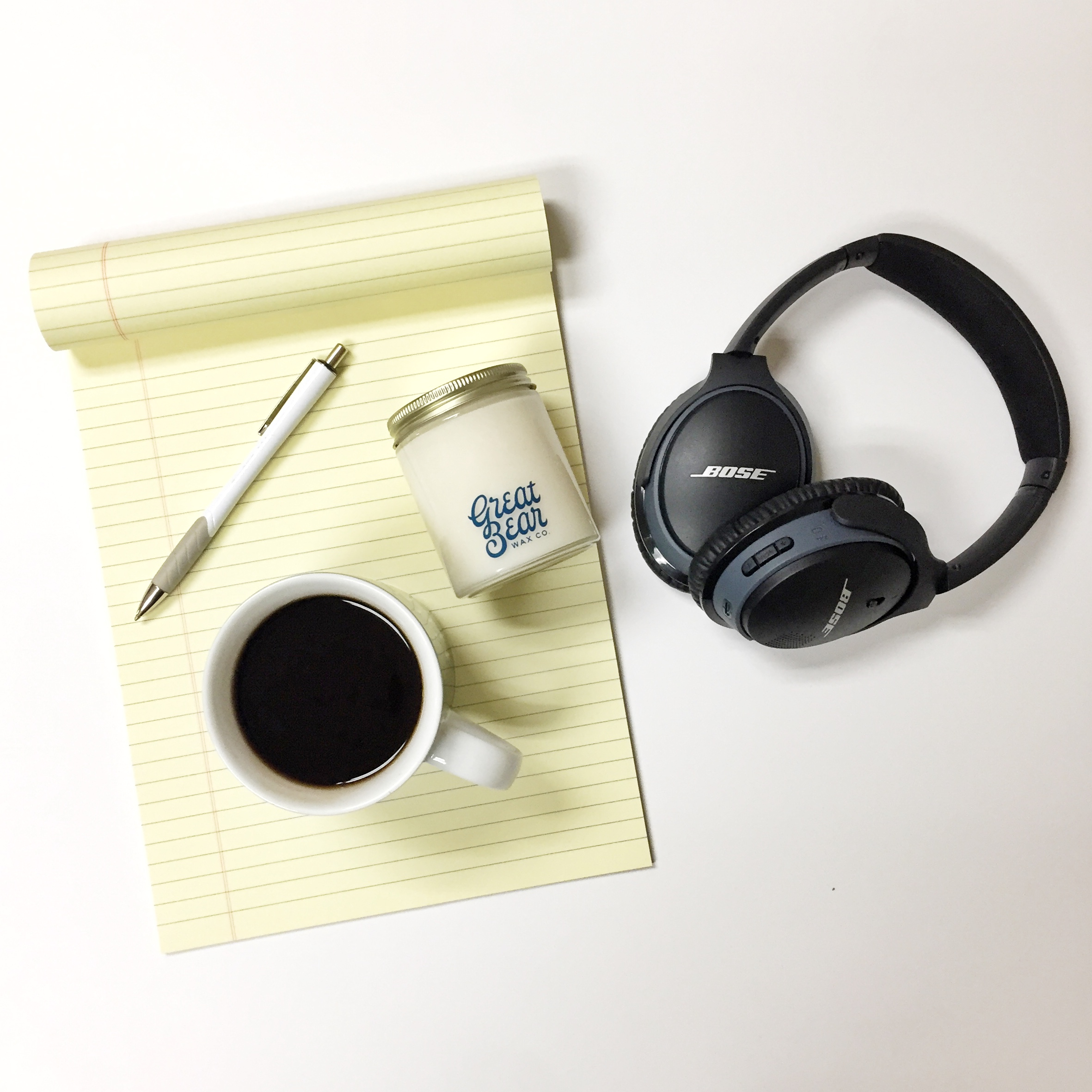 candle coffee headphones legal pad pen