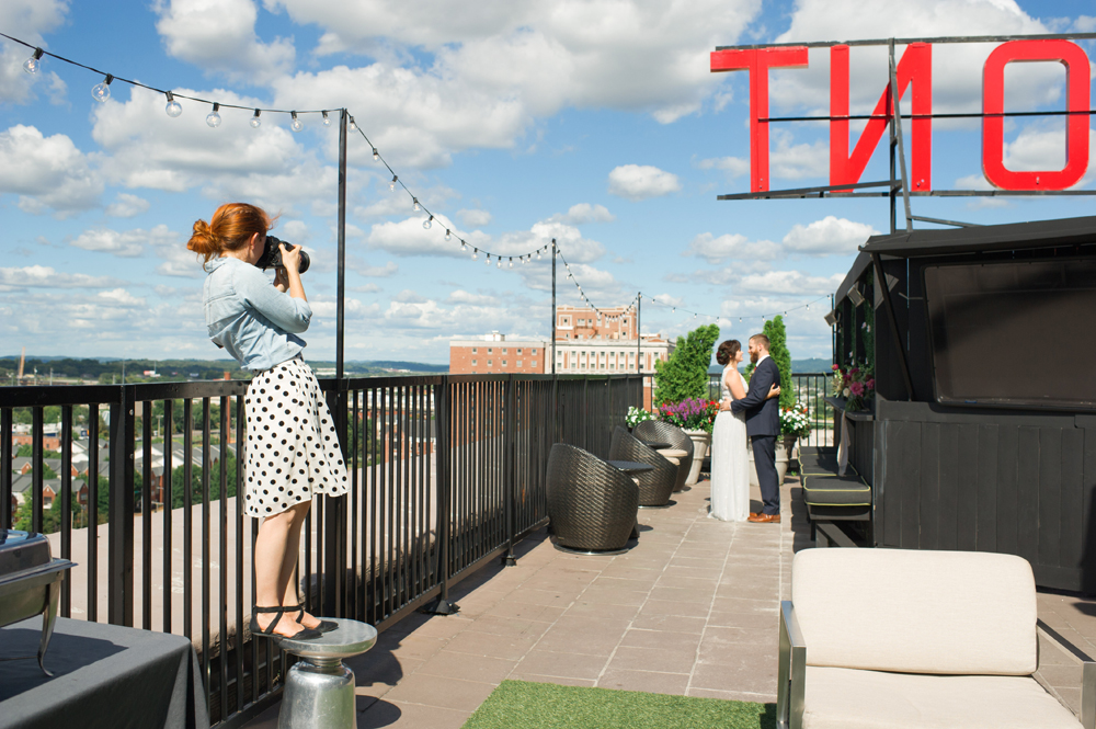 photographer shoots wedding picture on redmont hotel rooftop