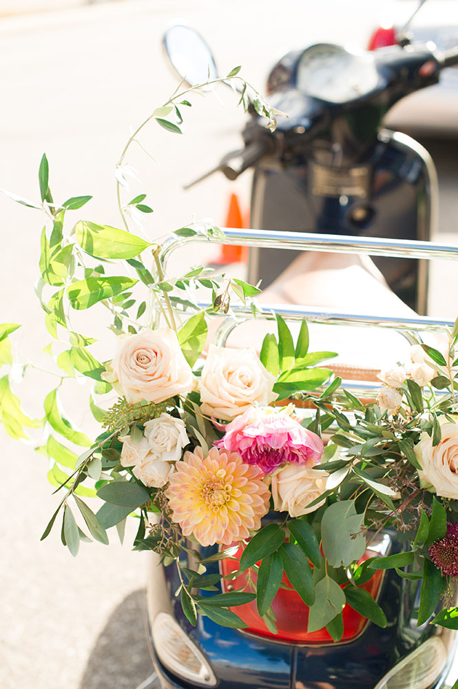 vespa with flowers on the back for a wedding