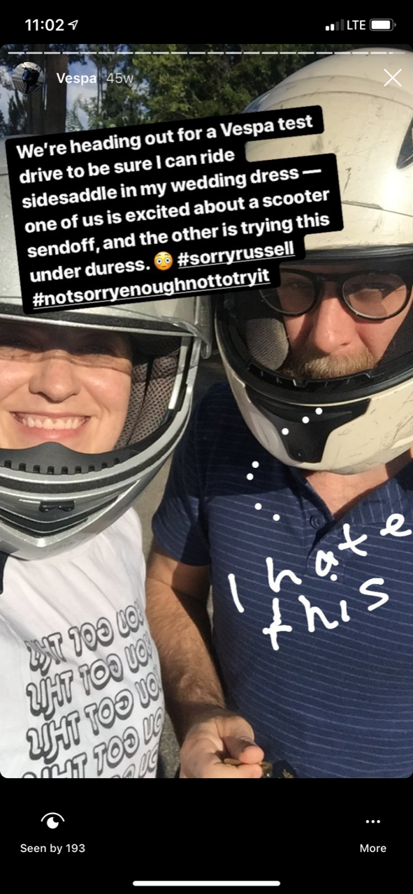 two people in vespa helmets
