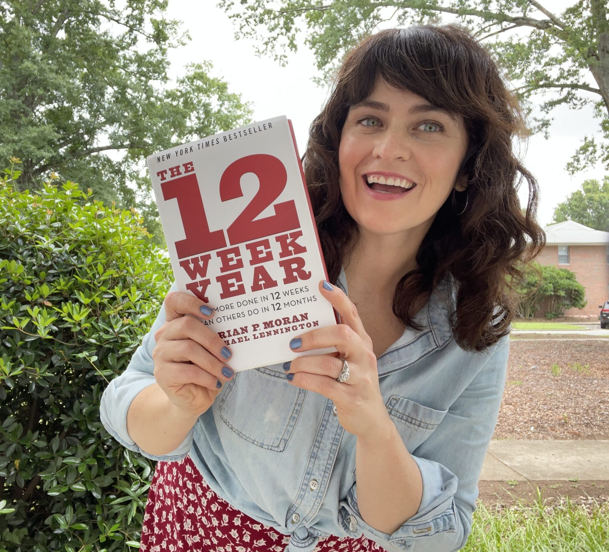 carrie rollwagen holds the 12 week year book
